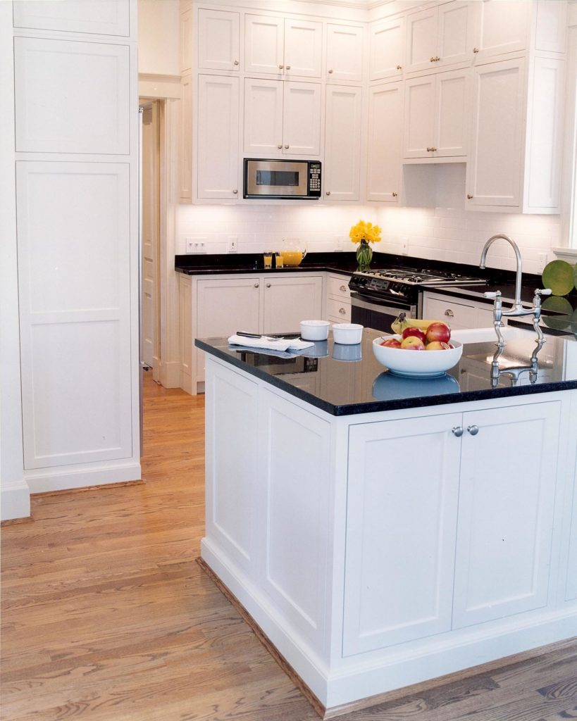 white kitchen black countertop